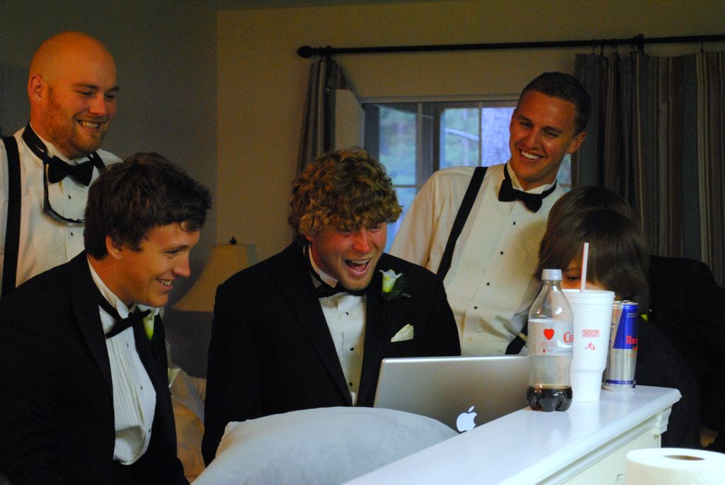 groom & groomsmen on photobooth minutes before wedding