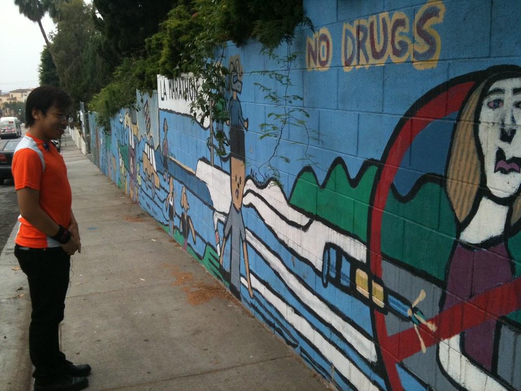 H.C. taking in the children's mural by Caroline on Crack