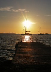 Lead the way.. ( Marlene ) Tags: sunset sea sun holiday seascape water glitter sanantonio clouds sailboat boats golden pier waves glow peaceful tranquility olympus calm sparkle ibiza serenity pointandshoot serene rays tranquil pointshoot balearicislands holidaysnap