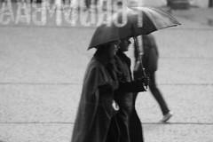 heavy rain (LetsLetsLets) Tags: bw paris france rain umbrella janeiro chuva pluie frana pb nb centrepompidou paraguas 2009 parapluie guardachuva