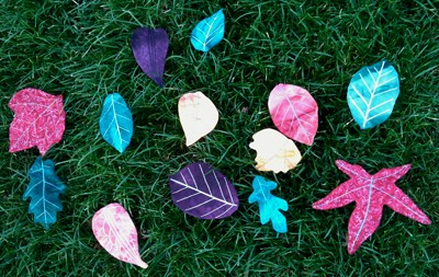 Quilted autumn leaves arranged on the grass