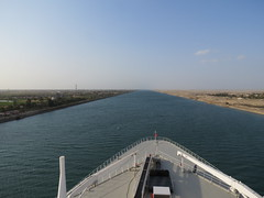 The Open Suez Canal (Skoda Girl) Tags: suez canal ship bow water egypt sand white blue sky clouds empty open