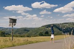summer day handstand. (H.R. Foto) Tags: idaroberstein handstand summer summerday outdoor signpost road path field sky bluesky clouds