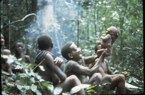 holding up baby at kugongea