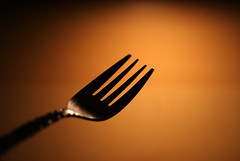 time to eat :-) (thbaz) Tags: orange black macro essen dof time eating sony group gabel fork eat 200 alpha makro schwarz materials zeit zu gegenstand tamron90mmmacro forkgroup