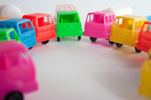Council of toy trucks of different colors in circle
