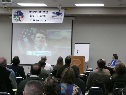 Participants at a Jobs Forum in Albany, Oregon watch a video presentation featuring Agriculture Deputy Secretary Merrigan