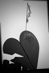 25/365 - You can have my heart if you don't mind broken things. (Micah Taylor) Tags: blackandwhite sculpture lomo heart steel flag fake crack poop torn tattered brid project365 brkoen