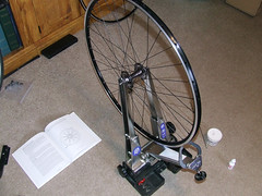 In the Truing Stand (aar0on) Tags: park sun bike bicycle wheel hub track spokes assault revolution rim pewter allcity sunringle wheelbuilding truingstand dtswiss butted doublebutted