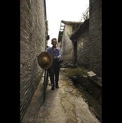 rewinding - China ( Tatiana Cardeal) Tags: guangzhou china old travel man hat bicycle digital ancient alley asia village chinese guangdong  2009 canton  canto chatang