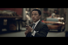 I Bet I Can Text Without Looking at my Phone (- Loomax -) Tags: street people urban newyork asian daylight manhattan candid 5thavenue suit cinematic warmcolors cinemascope yellowcabs