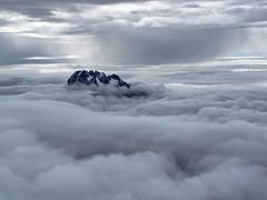 In The Clouds-Mawenzi Peak-Kilimanjaro Summit-Tanzania (mikemellinger) Tags: africa mountain snow ice kilimanjaro nature clouds sunrise trekking trek landscape tanzania volcano climb nationalpark scenery mt snowy peak glacier mount glaciers summit uhuru mawenzi highest intheclouds