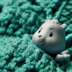 55/365 in which grumpy tries out the new afghan (mlsjs) Tags: toy aqua afghan carebear crocheted grumpy grumpybear object365 oneobject365daysproject
