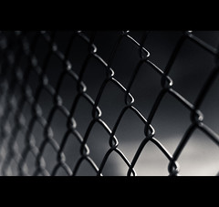 """""""Fear Is The Highest Fence"""" (©Komatoes) Tags: blackandwhite fence dark 50mm wire nikon moody f14 g 14 grain exeter nikkor afs wirefence d40"""