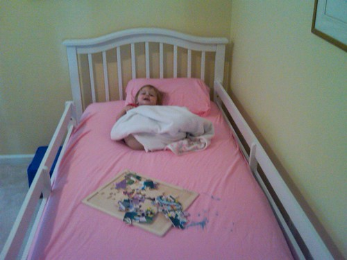 Maddie in her big girl bed after her crib was recalled