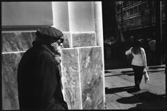 The Prowler. (Kiriakos Korakis (korax67)) Tags: street city blackandwhite bw woman man blancoynegro photography europe looking noiretblanc streetphotography athens greece hollywood fullframe nocrop contaxrx benaki panepistimiou ilfordxp2400super autaut distagon228  kiriakoskorakis korax67