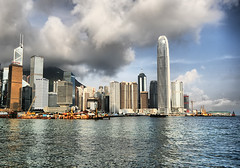 Hong Kong Waterfront (` Toshio ') Tags: china city morning light reflection water architecture clouds buildings asian hongkong harbor smog asia downtown cityscape waterfront cloudy chinese bearclaw tall ripples kowloon ifc hongkongisland victoriapeak victoriaharbor centraldistrict toshio ifctower internationalfinancialcentre chungwan