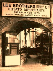 Borough Market (Victoria Limerick) Tags: door light sign sepia vintage gate arch market pavement bricks under victorian doorway boroughmarket borough inside boxes stalls slabs 1875 potatomerchants leebrothers