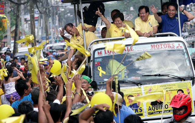 President Aquino campaigns on a Jeepney in Manila last year.