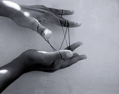 entanglements.. (dream_maze) Tags: thread ties freedom hands hand finger web fingers tie chain shackles bond bonds paradox struggle bindings extendedpalm veryclicheconcept
