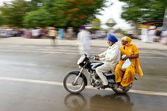 There's a long ribbon of asphalt in front of you, and your spirit can't be squeezed into the cubicles of a 9-to-5 world... (gurbir singh brar) Tags: travel nikon couple motorcycle biker sikhs turban punjab nikkor panning punjabi 2010 sirhind fatehgarhsahib 2470mmf28g gurbirsinghbrar nikond3s fatehdivas