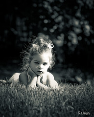 ...M... (Rebecca812) Tags: light portrait blackandwhite sunlight cute girl beautiful grass children outside kid eyes hands backyard child daughter thoughtful naturallight monotone m ribbon ponytail sundress canon5dmarkii familygetty2010