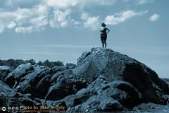 Watchful [50D-2607MonoBlue] (Juan N Only) Tags: blue lake monochrome landscape rocks outdoor michigan july shore duotone upperpeninsula gazing gaze lakesuperior 2010 copperharbor vigilant keweenaw vigilance keweenawpeninsula juannonly