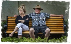 Photo caption needed...... (Kevin Povenz Thanks for the 3,300,000 views) Tags: 2017 june kevinpovenz westmichigan michigan holland hollandstreetperformers ottawa ottawacounty candid relaxing parkbench male female husband wife angry look canon7dmarkii street streetphotography