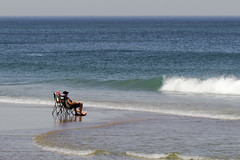 Watching the Waves (Up Close) (brucetopher) Tags: bach water sea ocean waves wave surf atlantic coast coastal seacoast coastline couple older life watch watching longing people wade site chair vacatin holiday weekend lowtide break green crest foam