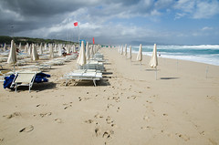 White and blu closed umbrellas (cromam) Tags: bathers bathing beach beachloungers beachumbrella cloudy colors fog holiday holidays italy prohibited redflag sadness sand sea stormy stormysea summer tourism touristic travel wind windy