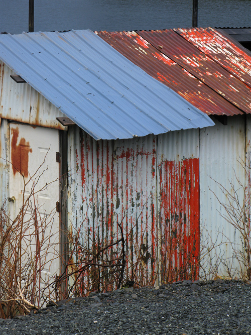 rust and paint and more color a shed in Hydaburg, Alaska