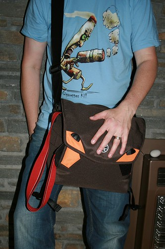 Stephen Mitchell, with Crumpler Bag, wearing Tom Godfrey Tshirt