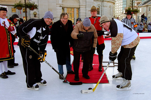 © Johnny Bower drops the puck for the official faceoff