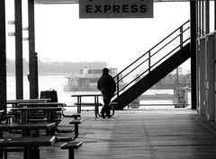 Expression (John Fraissinet) Tags: nyc man silhouette sign standing river boat ship cross legs streetphotography southstreetseaport tables express johnfraissinet streetobservationscom johnfraissinet