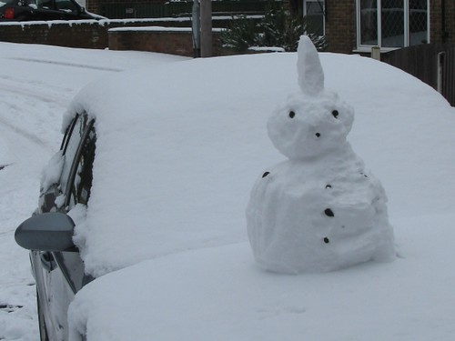 Punk snowman on car bonnet