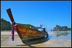 Low Tide Phi Phi. (konstantynowicz) Tags: sea sky sun sunlight colour reflection beach wet sunshine thailand boats island coast boat seaside sand colours phiphi bright tide sunny east shore thai canon350d ripples colourful fareast far longtail longtailboat krabi andaman andamansea longtailboats mygearandme mygearandmepremium mygearandmebronze
