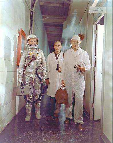 Astronaut John H. Glenn Jr., NASA flight surgeon William Douglas and equipment specialist Joseph W.