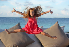 Fun on the beach (maria.feklistova) Tags: ocean travel vacation sun holiday beach nature girl smile sunshine hair fun happy kid jump jumping model child joy happiness journey blonde junior anastasia nastya raise acrobatic