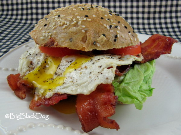 Fried Egg Sandwich Deluxe with Bacon on Pesto Pine Nut Bread