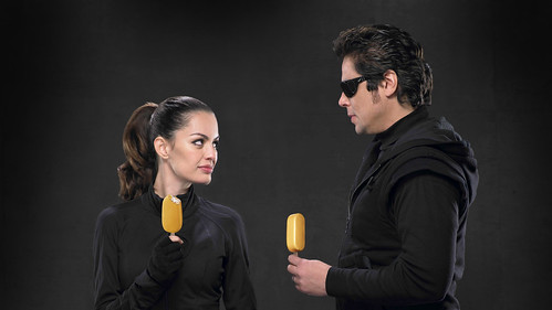 Benicio Del Toro and Caroline de Souza Correa with Magnum Gold