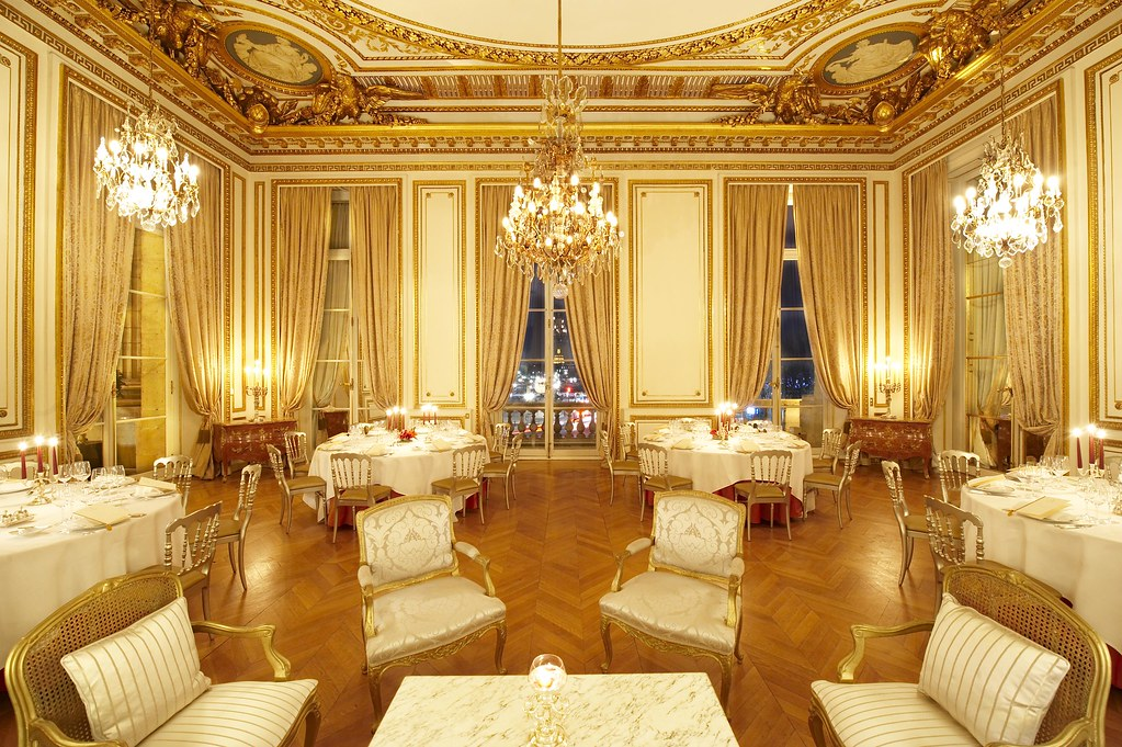 Les Aigles Reception Room, with Golden chandeliers and ornaments at the Hôtel de Crillon Paris, France