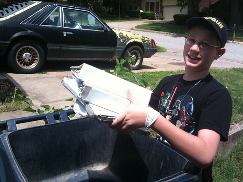 Alexander throwing away 6th grade paperwork