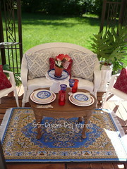 Come in out of the sun (SS-Designs Doll Interiors) Tags: blue red plants white garden cakestand table outdoors miniatures picnic silverware furniture flag barbie patriotic gazebo pillows deck rug dishes rement wicker diorama memorialday dollhouse redcups tablescape 16scale playscale ssdesignsdollinteriors bluewillowplates redandwhiteplates bluecrystalgoblets insidethebarbiecraftroom
