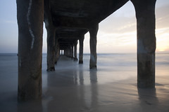 beneath the pier (mewtate) Tags: california sunset me pier wideangle manhattanbeachpier slowwater mewtate beachphotography beachliving amymew singhrayvarind