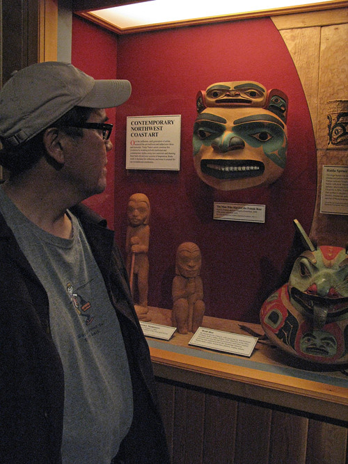 Norman Jackson looks at his own mask in the Alaska State Museum, Juneau, Alaska