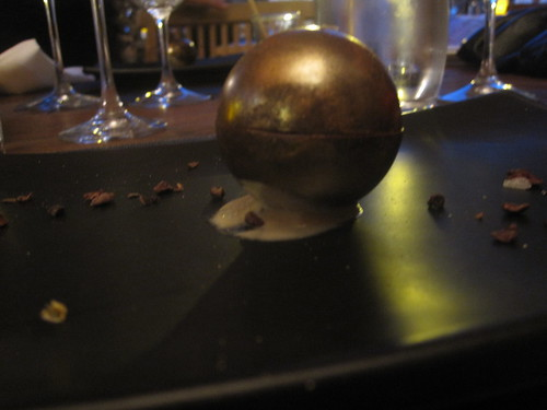 Golden dark chocolate sphere filled with a foie gras concoction