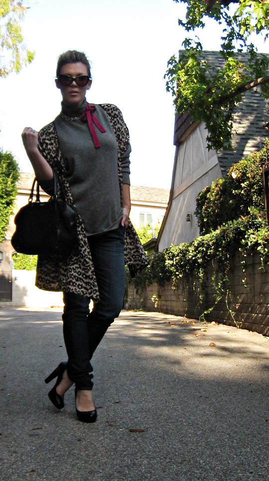 classic jeans and a sweater ladylike handbag and cat eye sunglasses