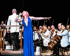 Fiddling with Storm Large (Tex Texin) Tags: fourthofjuly mountainview sanfranciscosymphony shorelinepark fireworks independenceday musician fiddler cello bluedress stormlarge singer redhead ginger girl female tuxedo violin stormof69 rockstar supernova instagram