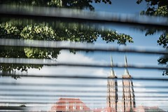 Reverse towers (Soren Wolf) Tags: wrocław wroclaw poland cathedral st john baptist water river bench mirror towers sky clouds cloud tower puddle nikon d7100