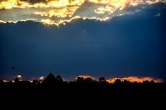 Day meets night... (Kerstin Winters Photography) Tags: landscape blue orange flickrnature flickr nikon nikkor nikondigital nikondsl landschaft wolken sonne sun night dark colorado clouds sky outdoor silhouette sonnenuntergang sunset